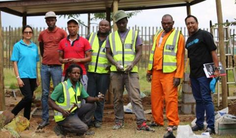 UNICEF South Africa Education Specialist, Dr Saadhna Panday-Soobrayan (L) and Communication Specialist, Sudeshan Reddy (R) with the construction team at Montsosi Primary School.