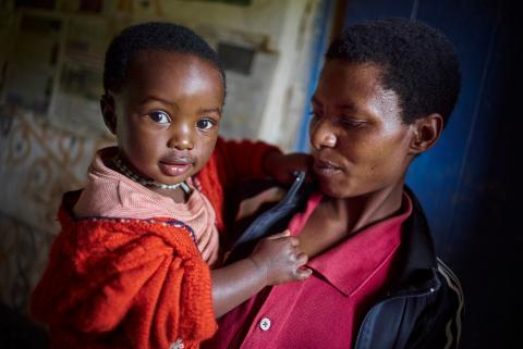 Mother holds her daughter in Malawi