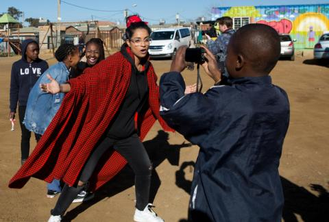 On 22 July 2018 in South Africa, (centre) UNICEF Goodwill Ambassador Lilly Singh interacts with a child during a visit to the Isibindi Safe Park in Soweto, 22 July 2018.