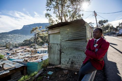 Odwa Gogwana, 18, overlooks the suburb of Hout Bay, from Imizamu Yethu Township in South Africa
