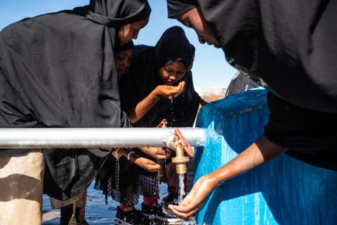 Young girls wash their hands at an EU-funded, UNICEF-supported water point in Somaliland.