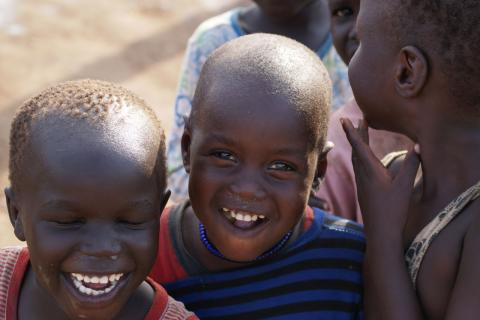 Children in South Sudan smiling and laughing