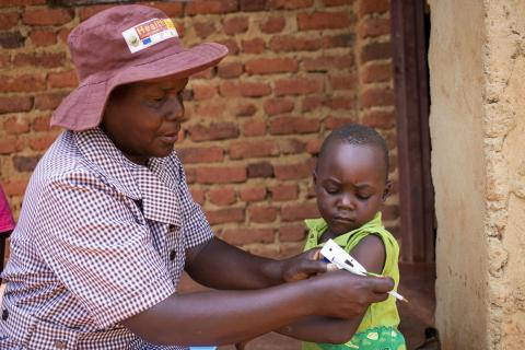 Community Health worker supported by Unicef, Tambudzai Vumisai (54) check Tinashe Uumisai (4) for signs of malnutrition at her house in Nyahode, Zimbabwe, Feb, 6, 2020