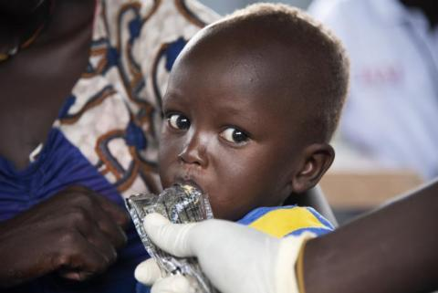 A young child receives therapeutic food