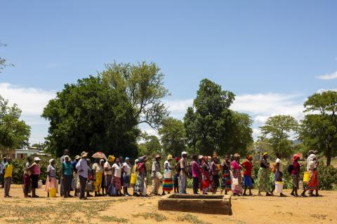 People line up to receive food aid in Manzwire village, Zimbabwe.