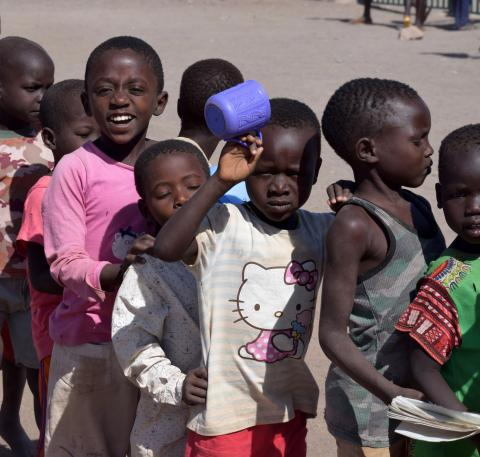 Children standing in a queue