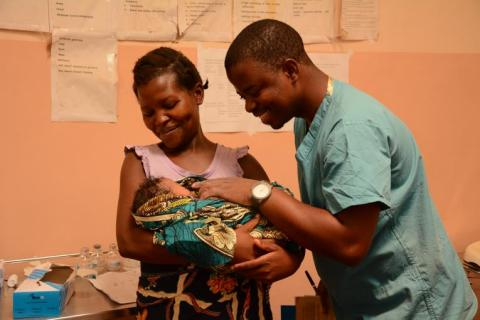 A doctor with a mother and her newborn baby at Bwaila Hospital in Lilongwe.