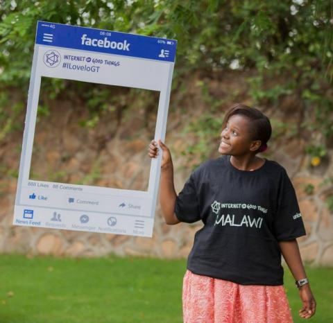 A girl hold an Internet of Good Things tag at the official launch in Lilongwe
