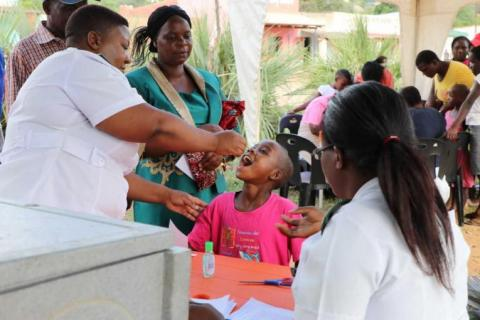 A child receives an oral vaccine