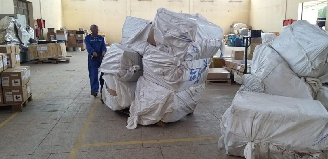 A cargo handler transports UNICEF supported supplies for COVID-19 that arrived at the Asmara airport
