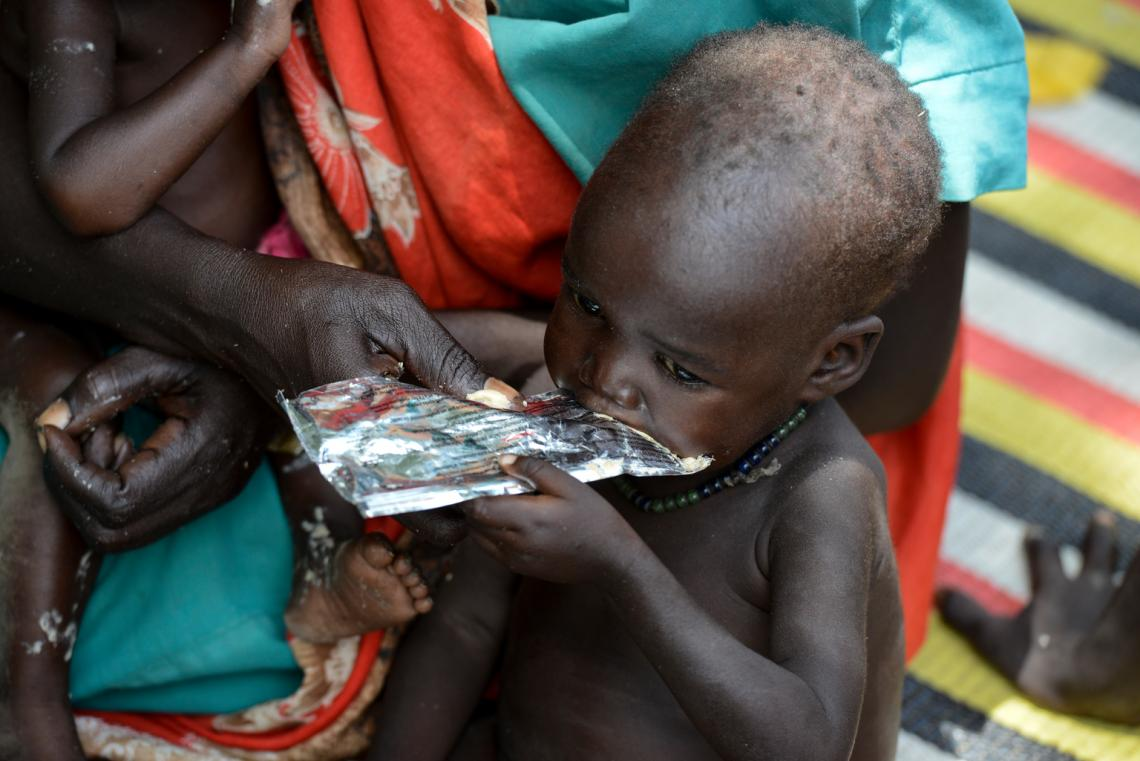 A child receives ready-to-use therapeutic food (RUTF) from a UNICEF-supported Out-Patient Therapeutic (OTP) site near the town of Aweil in South Sudan.