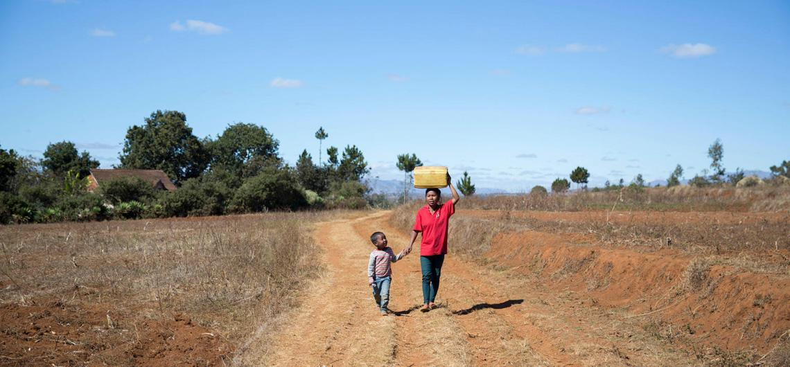 Gina walks to fetch water with her 5-year-old son, Rindra, in Antsirabe, Madagascar.