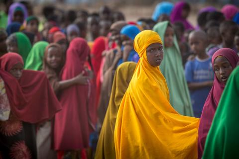 A group of Somali refugee students enter the school lined up by class at Melkadida primary school for host community and refugee children.