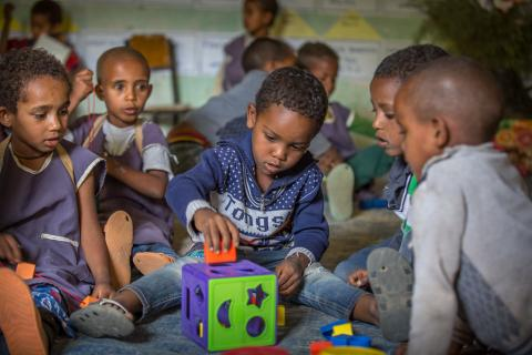 Abel Chane, 6, plays while his friends watching in Mequat Primary School in Kilete Awelalo woreda, Tigray region, Ethiopia.