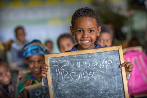 Abel Chane, 6, is happy to show his writing skills to the class. Abel will be in grade 1 next year acquiring critical educational and social skills which will help him succeed further.  Despite the proven and lifelong benefits, more than 175 million children – nearly half of all pre-primary-age children globally – are not enrolled in pre-primary education. In low-income countries, the picture is bleaker, with only 1 in 5 young children enrolled.
