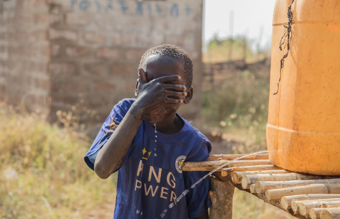 Feysel Ali, 8 and a grade 2 student washing his face at Tsetse Adurnunu primary school, Benishangul Gumuz
