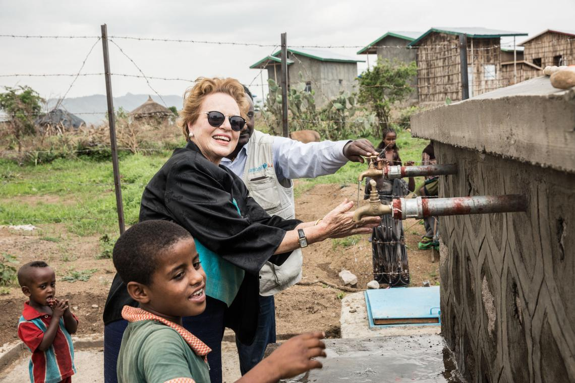 Ms. Gillian Mellsop, UNICEF Representative to Ethiopia poses to take a picture with a local boy at the UNICEF/DIFID supported community emergency water supply scheme at Woiru Dikala Kebele, Raya Kobo woreda, Amhara region.