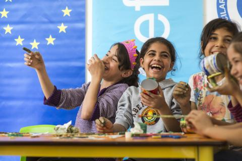 Syrian refugee children laugh while enjoying at a craft workshop at the UNICEF supported Al Farah Center in Gaziantep Turkey (implemented jointly with ASAM).