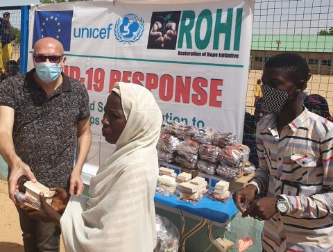 Distribution of masks and soap at a stand in Nigeria
