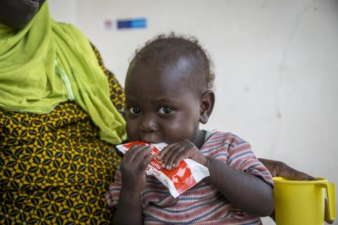 Oumou Bah, 2 years old, suffers from severe acute malnutrition takes his Plumpy'Nut