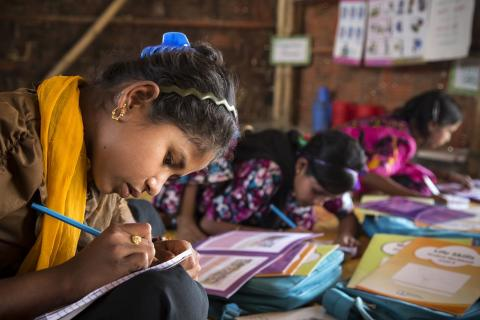 On 24 February 2019 in Bangladesh, a girl studies with new UNICEF-supported learning materials in class of level 4-5 in a learning centre in Camp 18 Kutupalong refugee camp in Cox's Bazar.