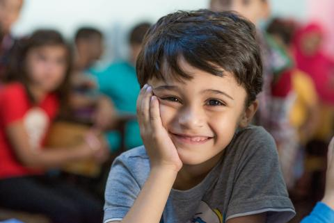 Young Syrian refugee child at learning center in Turkey