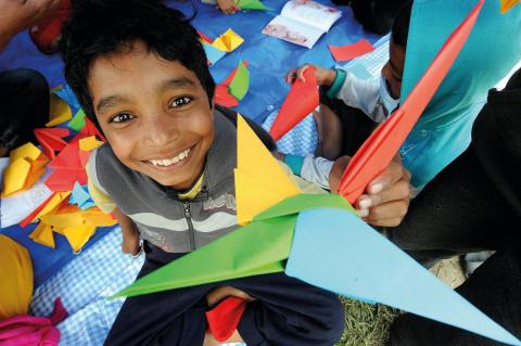 On 30 April, children play in a tent housing a UNICEF-supported child-friendly space in Tundikhel, a large grass-covered area and important landmark in Kathmanudu, the capital.
