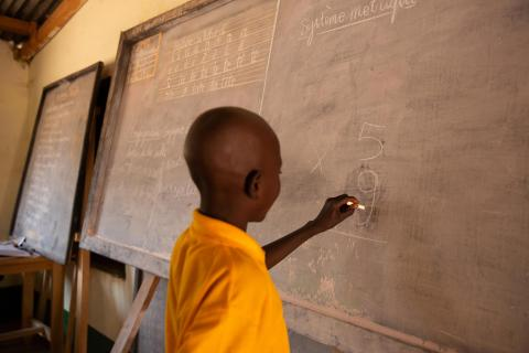 In 18 February 2020, a student solves a mathematical equation in a classroom at Paoua Accelerated Learning Centre, a school located in the town of Paoua, in the Central African Republic.