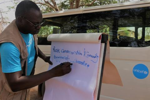 UNICEF staff trains communities on risk communication