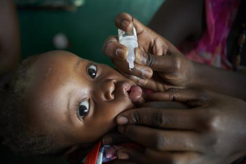 A child receives immunization at health facility