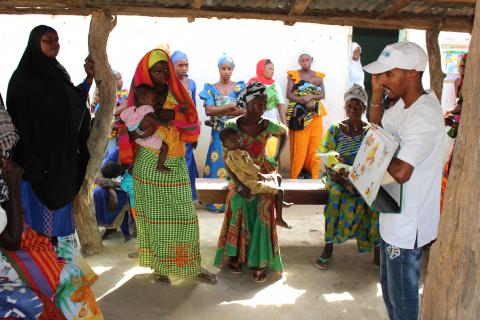 Health worker providing nutrition education for women at a local clinic