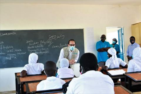 UNICEF Representative in The Gambia, Gordon Jonathan Lewis speaks to students in Kaiaf, a week after they returned to school