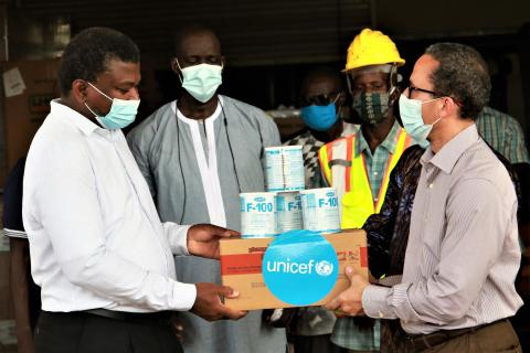 UNICEF The Gambia Representative, Gordon Jonathan Lewis hands over nutrition supplies to the Minister of Health, Dr Ahmadou Lamin Samateh