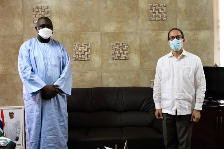 UNICEF The Gambia Representative, Gordon Jonathan Lewis and Minister of Justice Dawda Jallow pose for a photo after a meeting