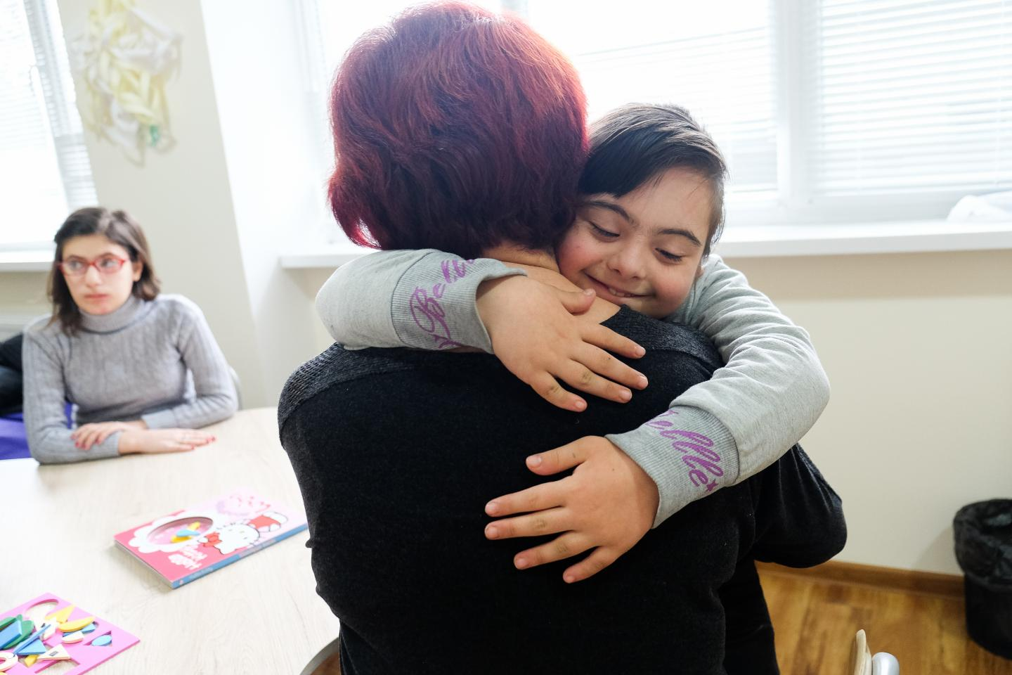 Karina, 10, hugging her mother Gaiane