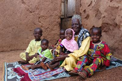 Zamigu Issah, the local Imam, with his children and grandchildren in the village of Kpano in the Northern Region of Ghana on 18 July 2015.