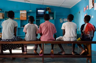 Children watching the television while they wait for breakfast at the state Shelter for Abused Children in Accra, Ghana on 12 May 2015.