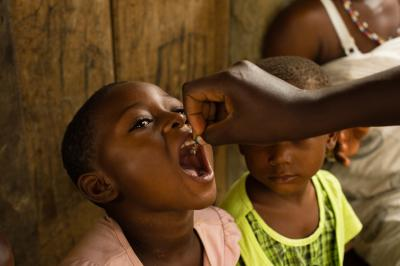 A child receiving a dose of vitamin A in the village of Kekereke in the Birim Central District of the Eastern Region of Ghana on 5 June 2013, during a National Immunization Days (NID) polio eradication campaign.