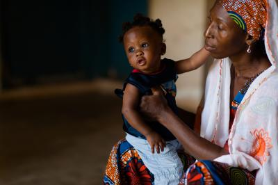 Lamnatu Amadu with her daughter, Salma Abass, at a clinic for children suffering from acute malnutrition at a Nutrition Rehabilitation Centre in Tamale in the Northern Region of Ghana on 14 July 2015.