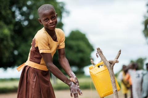 Pognaa Jebuni (12) demonstrating how she washes her hands at a tippy tap at Guo District Assembly Primary School in the Upper West region of Ghana.