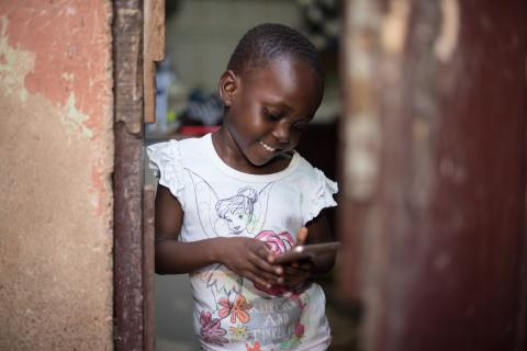 young girl looking at her phone