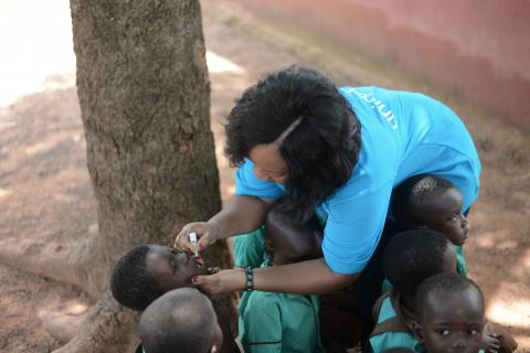 A UNICEF staff member vaccinates a young boy in Sagnarigu in the Northern Region