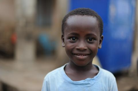 A young boy in the town of Elmina in Ghana
