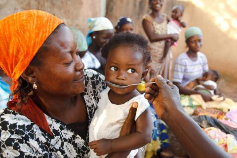 Awabu Abdulay gives a child some solution of oral rehydration salts (ORS) in the village of Moglaa, Ghana on Friday November 12, 2010