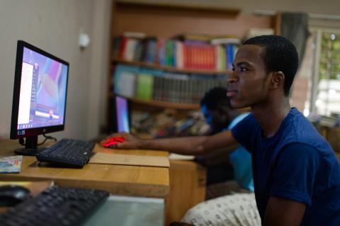 Emmanuel using a computer at the Osu Children's Home in Accra, Ghana in 5 May 2015.