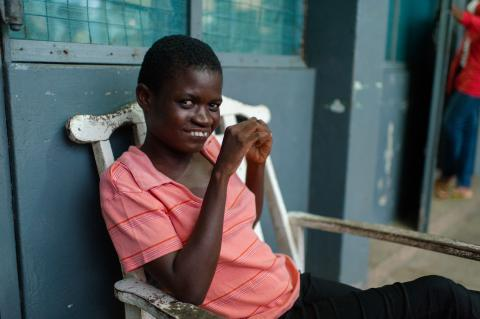 Florence, a child with special needs, sitting y herself outside a girls' common room at the Osu Children's Home in Accra, Ghana in 5 May 2015.