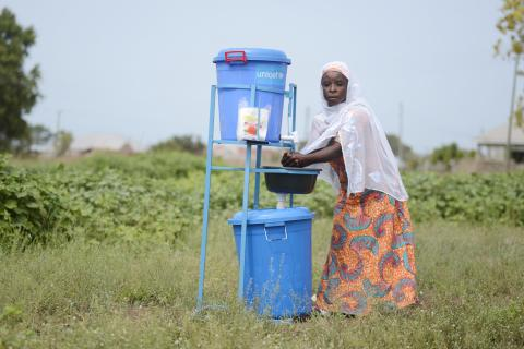 A woman washing her hands at a UNICEF-provided hand washing facility