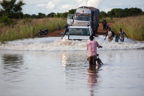 A UNICEF vehicles submerged in water as it amkes it's way through a flooded road