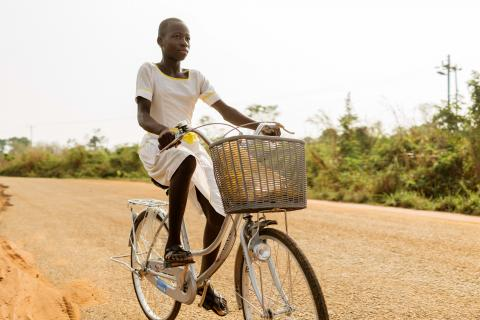 A girl riding her bicycle to school