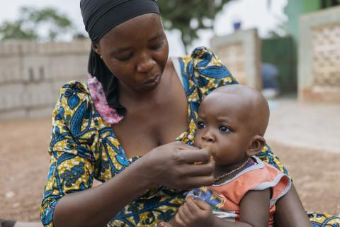 Adama feeds her son Saeed with fruits, meat and fish, depending on what is in season in Tolon, Ghana on 10 April 2018.